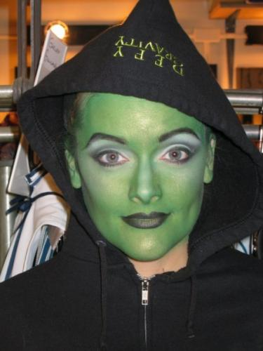 Gaelen in the green witch make-up in Wicked